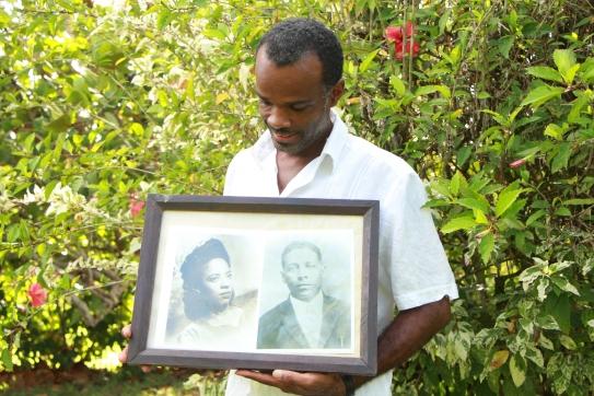 Reynaldo Matthews holds the portrait of his grandparents
